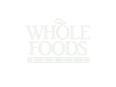 Whole Foods Market logo on forest green background